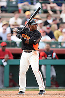 Miguel Tejada #10 of the San Francisco Giants bats against the Arizona Diamondbacks in the first spring training game of the season at Scottsdale Stadium on February 25, 2011  in Scottsdale, Arizona. .Photo by:  Bill Mitchell/Four Seam Images.
