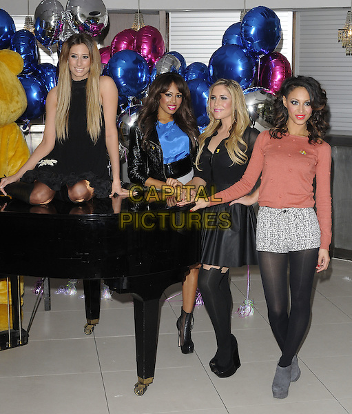 STACEY SOLOMON & SUGABABES (JADE EWEN, HEIDI RANGE & AMELLE BERRABAH).The BBC Children In Need POP Goes The Musical launch photocall, the Roof Gardens, Kensington High St., London, England..August 31st, 2011.full length black dress tights grey gray skirt leather jacket blue top pink shorts pattern sitting sleeveless grand piano.CAP/CAN.©Can Nguyen/Capital Pictures.