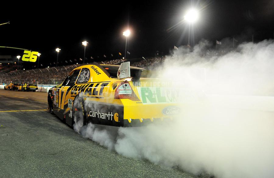 Apr 18, 2009; Avondale, AZ, USA; NASCAR Sprint Cup Series driver Matt Kenseth spins the tires after pitting during the Subway Fresh Fit 500 at Phoenix International Raceway. Mandatory Credit: Mark J. Rebilas-