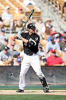 Paul Konerko #14 of the Chicago White Sox plays in a spring training game against the Texas Rangers at Camelback Ranch on March 12, 2011 in Glendale, Arizona. .Photo by:  Bill Mitchell/Four Seam Images.