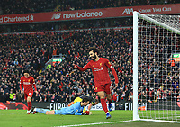1st February 2020; Anfield, Liverpool, Merseyside, England; English Premier League Football, Liverpool versus Southampton;  Mohammed Salah of Liverpool celebrates after beating Alex McCarthy of Southampton to score after 71 minutes