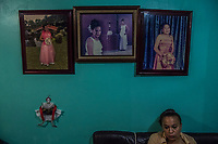 Vicky Delgadillo sits below photo's of her missing daughter at her home in Xalapa, Mexico on November 4, 2017. <br /> Photo Daniel Berehulak for The New York Times