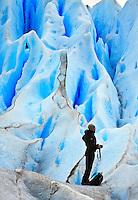 A photographer on the blue ice of Glacier Perito Moreno, in Parque Nacional los Glaciares, Argentina.