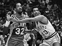 Golden State Warriors Wayne Cooper guarding Atlanta Hawks Dan Roundfield #32.(1980 photo/Ron Riesterer)