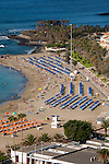 Parasols on sandy beach Los Cristianos / Playa de las Americas.Tenerife, Canary Islands
