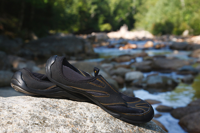 Water shoes on rock along the Swift River. This river is located along the Kancamagus Highway (route 112) which is one of New England's scenic byways. Located in the White Mountains, New Hampshire USA