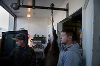 Workers prepare deer and elk carcasses to be skinned and butchered at House of Meats in Great Falls, Montana, USA.