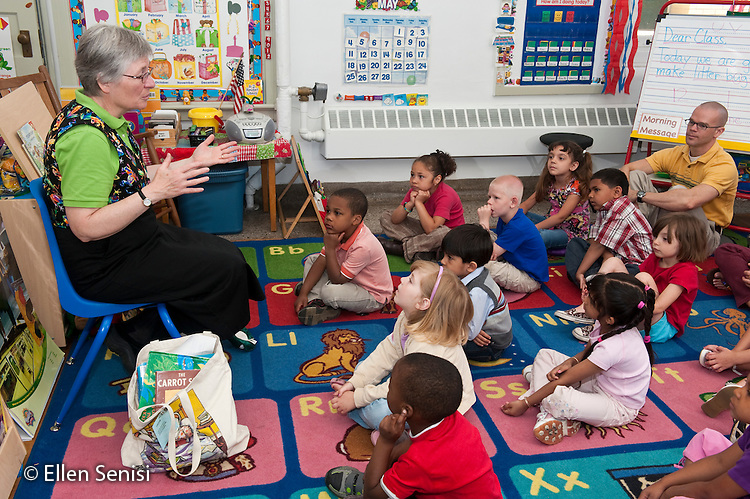 MR / Schenectady, New York. Fulton Early Childhood Education Center (urban public school early childhood education center). Pre-K classroom. Librarian from city library visits classroom for special literacy lesson as part of a community outreach program. In this component of the lesson, she uses her hands while story telling. ID: AI-gPd. MR: Gif1 ©Ellen B. Senisi
