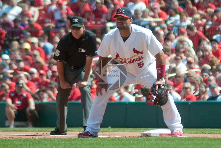 April 3,  2011                           St. Louis Cardinals first baseman Albert Pujols (5) covers first base.  Behind him is first base umpire Tim Timmons (95). The St. Louis Cardinals defeated the San Diego Padres 2-0 in the final game of a three-game series on Sunday April 3, 2011 at Busch Stadium in downtown St. Louis.