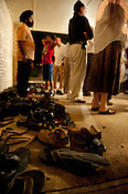 Attendees leave their shoes at the door during the gathering at the Sikh Gurudwara of North Carolina in Durham to honor the victims of the Oak Creek shooting on Wednesday August 8th 2012.