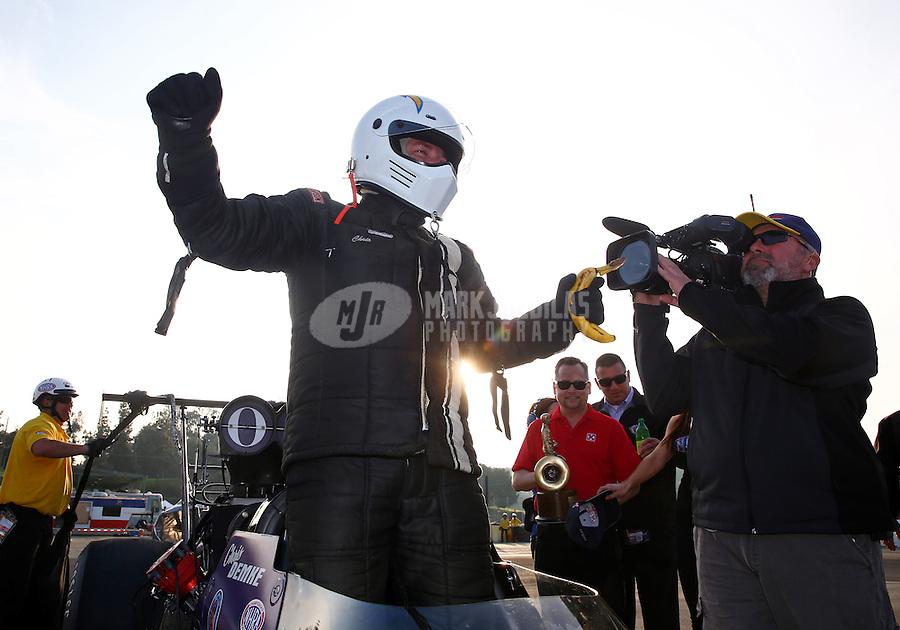 Feb 9, 2014; Pomona, CA, USA; NHRA top alcohol dragster driver Chris Demke celebrates after winning the Winternationals at Auto Club Raceway at Pomona. Mandatory Credit: Mark J. Rebilas-