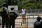 Israeli police inspect a Palestinian youth after they stripped him of his clothes as he tries to attend the prayer on the third Friday of the holy month of Ramadan outside Damascus gate in Jerusalem's Old City July 18, 2014. An Israeli police spokesman said on Friday that police allowed only Palestinian men over the age of 50 to enter a compound and added that seven people were detained on suspicion of throwing stones at police officers after the prayers on the compound. Photo by Saeed Qaq