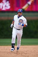 Chicago Cubs outfielder Kyle Schwarber (12) runs the bases after hitting a home run during a game against the Milwaukee Brewers on August 13, 2015 at Wrigley Field in Chicago, Illinois.  Chicago defeated Milwaukee 9-2.  (Mike Janes/Four Seam Images)