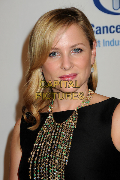 JESSICA CAPSHAW.EIF's Women's Cancer Research Fund Benefit held at the Beverly Wilshire Hotel, Beverly Hills, California, USA..January 27th, 2010.headshot portrait black gold necklaces beads beaded.CAP/ADM/BP.©Byron Purvis/AdMedia/Capital Pictures.