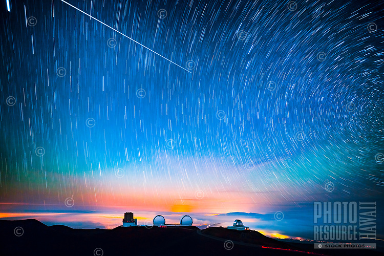 A long-exposure image of the starry evening sky over the observatories at Mauna Kea, Big Island.