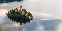 Lake Bled rowing boat (Pletna) at Lake Bled Island at sunrise, Gorenjska, Slovenia, Europe
