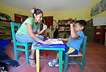 Elizabet Ramirez Avendaño teaches sign language to Felipe de Jesus Piña Alonso, a 6-year old deaf boy, during a class at Piña Palmera, a center for community based rehabilitation for people living with disabilities in Zipolite, a town in Oaxaca, Mexico.