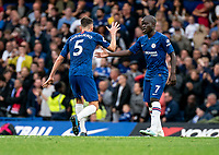 N'Golo Kante of Chelsea is congratulated by Jorginho of Chelsea after scoring during the Premier League match between Chelsea and Liverpool at Stamford Bridge, London, England on 22 September 2019. Photo by Liam McAvoy / PRiME Media Images.
