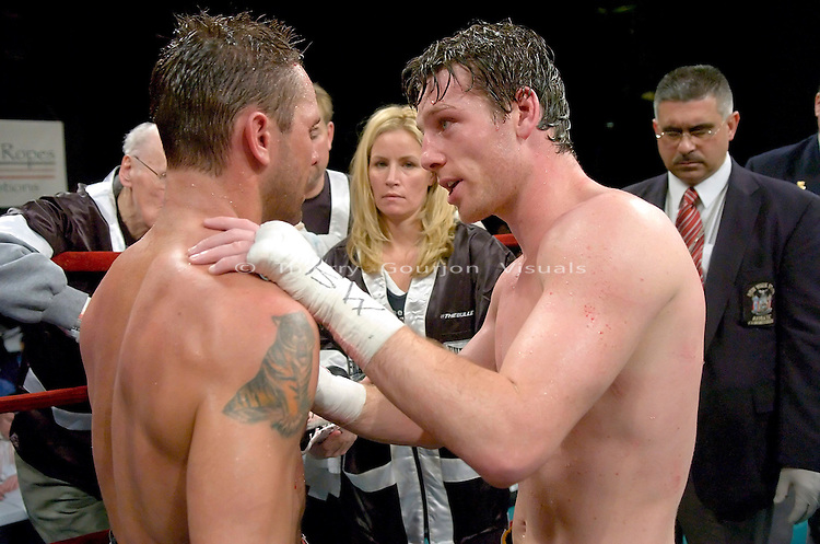"""Ireland's"" John Duddy and  Anthony ""The Bullet"" Bonsante embrace after  their  IBA World & WBC Continental Americas Middleweight Championship at the Garden in New York City on 03.16.07..Duddy won by technical decision after 9 rounds. Photo by Thierry Gourjon."