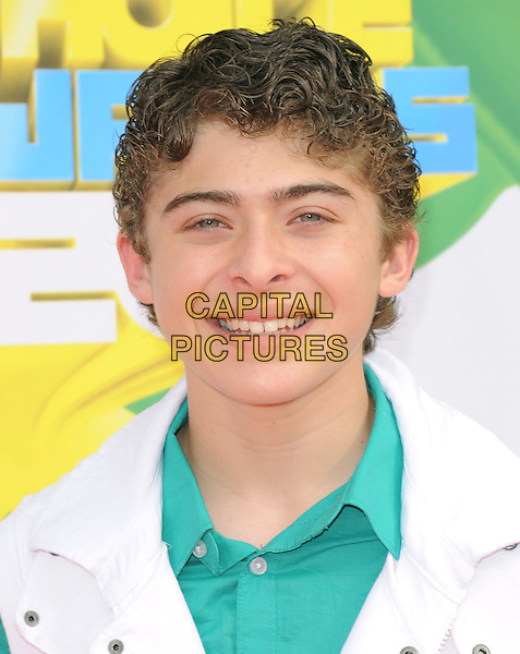 RYAN OCHOA .attending The 24th Annual Kids' Choice Awards held at USC's Galen Center in Los Angeles, California, USA, .April 2nd 2011..portrait headshot green shirt white smiling  .CAP/RKE/DVS.©DVS/RockinExposures/Capital Pictures.