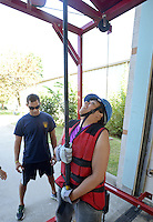 NWA Democrat-Gazette/BEN GOFF &bull; @NWABENGOFF<br /> Edward Maria, firefighter with the Fayetteville Fire Department, shows candidate Melissa Harris of Centerton how to perform the ceiling breach and pull event on Saturday Aug. 15, 2015 at Springdale Fire Department station No. 1 before Harris and other prospective firefighters take the Candidate Physical Ability Test. Candidates have 10 min, 20 sec. to complete a course with eight events, all while wearing a 50 lbs. weight vest. Candidates have three opportunities over several weeks to pass the test, earning certification that will be recognized by participating departments around the country as part of the application process for firefighting positions.