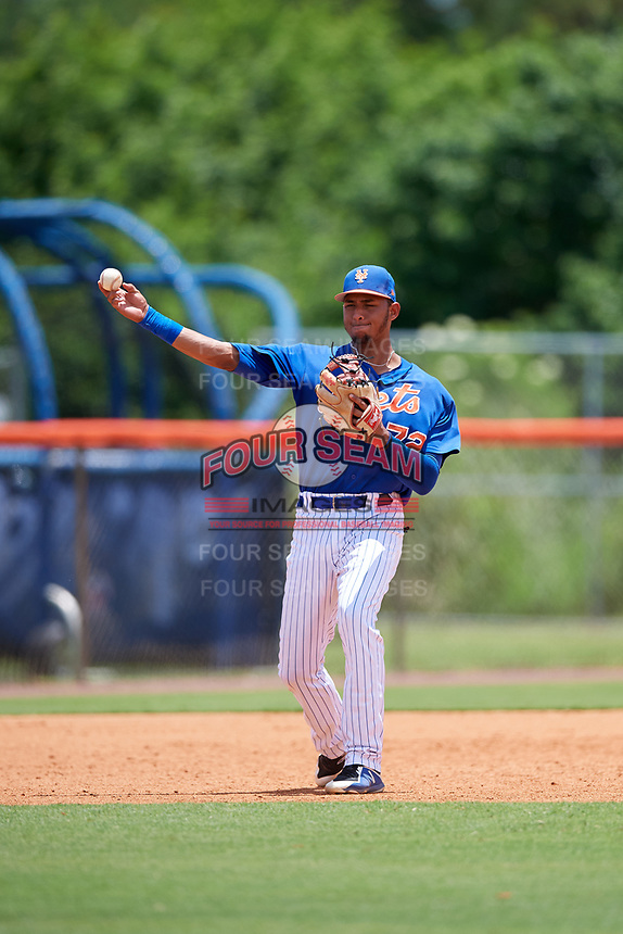 GCL Mets third baseman Cristopher Pujols (72) throws to first base during a game against the GCL Marlins on August 3, 2018 at St. Lucie Sports Complex in Port St. Lucie, Florida.  GCL Mets defeated GCL Marlins 3-2.  (Mike Janes/Four Seam Images)