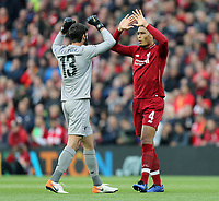 Liverpool's Alisson Becker (left) and Virgil van Dijk greet each other ahead of kick-off<br /> <br /> Photographer Rich Linley/CameraSport<br /> <br /> UEFA Champions League Semi-Final 2nd Leg - Liverpool v Barcelona - Tuesday May 7th 2019 - Anfield - Liverpool<br />  <br /> World Copyright © 2018 CameraSport. All rights reserved. 43 Linden Ave. Countesthorpe. Leicester. England. LE8 5PG - Tel: +44 (0) 116 277 4147 - admin@camerasport.com - www.camerasport.com