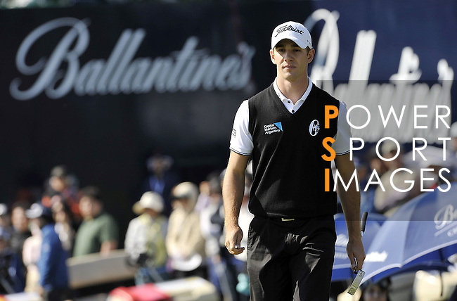 JEJU, SOUTH KOREA - APRIL 25:  Tano Goya of Argentina walks into the 18th green during the Round Three of the Ballantine's Championship at Pinx Golf Club on April 25, 2010 in Jeju, South Korea. Photo by Victor Fraile / The Power of Sport Images