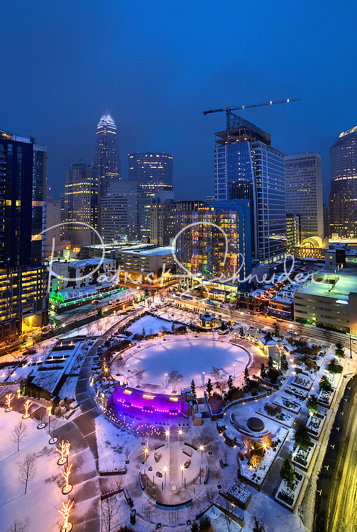Charlotte Skyline Photography - Photography of Romare Bearden Park covered in snow  in uptown Charlotte North Carolina.<br /> Snow scenes in uptown Charlotte.<br /> <br /> Charlotte Photographer - PatrickSchneiderPhoto.com