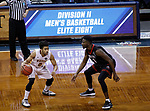 SIOUX FALLS, SD: MARCH 20:  Ian Smith #0 of Northern State looks past East Stroudsburg defender Kobi Nwandu #1 during their game at the 2018 Division II Men's Elite 8 Basketball Championship at the Sanford Pentagon in Sioux Falls, S.D. (Photo by Dick Carlson/Inertia)