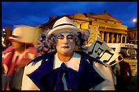 With the Solis theatre in the background Tabare Charlo  is seen moments before the start of the inaugural parade of the Uruguayan Carnival, January 30, 2004, in Montevideo's Plaza Independencia.