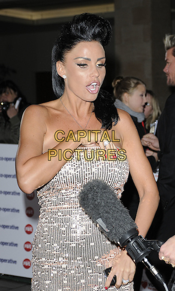 KATIE PRICE (JORDAN) .The Co-operative Variety Club Showbiz Awards, Grosvenor House Hotel, Park Lane, London, England, UK, .14th November 2010. .half length strapless silver sequined sequin dress shoes platform  fake tanned tan microphone interview mouth open talking hand ring funny .CAP/CAN.©Can Nguyen/Capital Pictures.