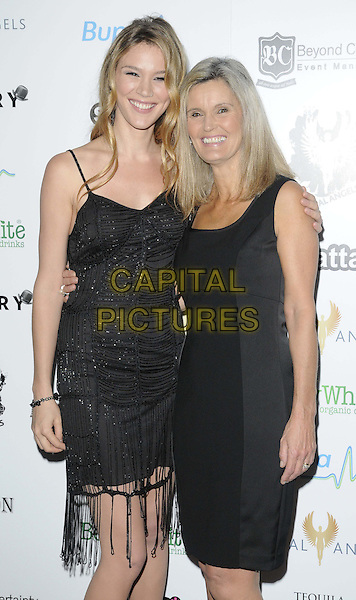 Joss Stone & Wendy Stone.attended the Global Angel Awards Angels in Concert, The Brewery, Chiswell Street, London, England, UK, .9th November 2012..half length black dress beaded mother mom mum daughter family tassels flapper fringed .CAP/CAN.©Can Nguyen/Capital Pictures.
