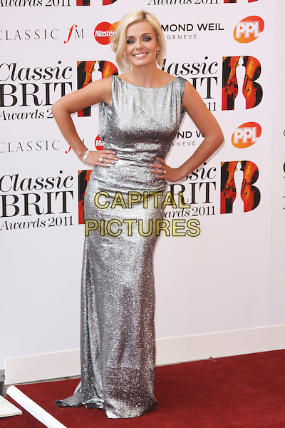 KATHERINE JENKINS .Arriving to the Classical Brit Awards 2011 at the Royal Albert Hall, London, England, UK, 12th May 2011..arrivals brits full length shimmery shiny silver dress  long maxi  sleeveless hands on hips .CAP/AH.©Adam Houghton/Capital Pictures.