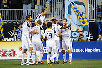 Edson Buddle (14) of the Los Angeles Galaxy celebrates scoring a goal with teammates. The Los Angeles Galaxy defeated the Philadelphia Union  1-0 during a Major League Soccer (MLS) match at PPL Park in Chester, PA, on October 07, 2010.