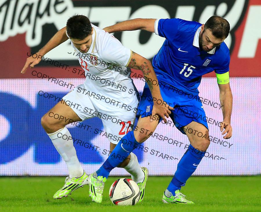 Fudbal<br /> Prijateljski mec-Friendly match<br /> Srbija v Grcka<br /> Aleksandar Mitrovic (L) and Vassilis Torosidis<br /> Chania, 17.11.2014.<br /> foto: Srdjan Stevanovic/Starsportphoto &copy;
