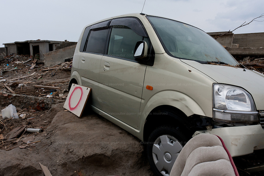 A tsunami damaged car left by a seawall near Minami Soma in Fukushima, Japan Tuesday, May 3rd 2011