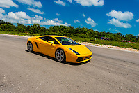 Lamborghini Gallardo on the track at Exotic Rides Mexico. Exotic Rides Mexico gives guests the opportunity to drive the most exotic and exclusive cars in the world on a 1.1 mile private race track in Cancun, Quintana Roo, Mexico