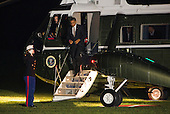 United States President Barack Obama walks down the steps from Marine One on the South Lawn of the White House in Washington, D.C. after returning home from a series of campaign events across the country on October 25, 2012. .Credit: Kristoffer Tripplaar  / Pool via CNP