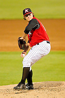 Relief pitcher Nick McCully #12 of the Kannapolis Intimidators in action against the Lakewood BlueClaws at Fieldcrest Cannon Stadium on July 16, 2011 in Kannapolis, North Carolina.  The Intimidators defeated the BlueClaws 5-3.   (Brian Westerholt / Four Seam Images)