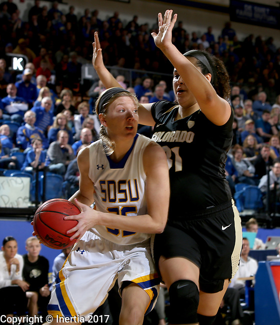 BROOKINGS, SD - MARCH 19:  Tiffaney Flaata #35 from South Dakota State looks for a teammate while being pressured by Zoe Beard-Fails #31 from Colorado during their second round WNIT game at Frost Arena March 19, 2017 in Brookings, South Dakota. (Photo by Dave Eggen/Inertia)