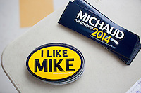 "Bumperstickers and posters reading ""I Like Mike"" in support of Representative Mike Michaud's (Democrat from Maine's Second Congressional District) campaign for governor lay on a table at the Portland Democratic City Committee town caucus in the East End School cafeteria in Portland, Maine, USA, on March 3, 2014. Michaud is running for governor in 2014. The town caucus had speeches from various other local candidates and also served to choose delegates for the 2014 Maine State Democratic Caucus."