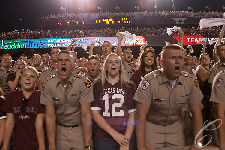 Aggie students yell and wave &quot;12th Man&quot; towels at a Texas A&amp;M football game at a Kyle Field against Oklahoma State in 2007.  <br /> <br /> Students stand throughout the entire game to show their support for the team.  A&amp;M's Corps of Cadets members traditionally have brought dates to sit with them at Aggie home games.