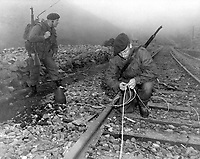 Commandoes of the 41st Royal British Marines plant demolition charges along railroad tracks of enemy supply line which they demolished during a commando raid, 8 miles south of Songjin, Korea.  April 10, 1951. (Navy)<br /> NARA FILE #:  080-G-428242<br /> WAR & CONFLICT BOOK #:  1434
