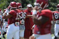 NWA Democrat-Gazette/ANDY SHUPE<br /> Arkansas coach Bret Bielema watches Saturday, Aug. 8, 2015. during practice at the university football practice field in Fayetteville.