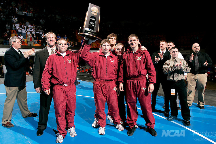 2008 Mar 08: The Coe College Wrestling team celebrates their fourth place finish at the 2008 NCAA Division III Wrestling Championship at the U.S. Cellular Center in Cedar Rapids, IA.  The Kohawks finished with 78 points.  Trevor Brown, Jr./NCAA Photos.