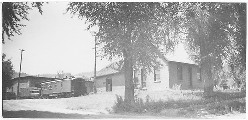 Ridgway offices with business car and Goose #2 at roundhouse.<br /> RGS  Ridgway, CO  Taken by Arend, Lad G.