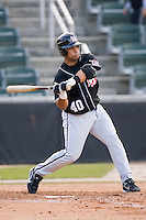 Catcher Ronald Pena (40) of the Hickory Crawdads takes his swings versus the Kannapolis Intimidators at Fieldcrest Cannon Stadium in Kannapolis, NC, Sunday April 13, 2008.