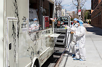 NEW YORK, NY - April 14: A group of medical workers receives free meals outside Wyckoff Heights Medical Center on April 14, 2020 in Brooklyn, NY. The global number of deaths from COVID-19 has reached 122,000 and infected more than 1.9 million people. Experts believe the number may be greater. (Photo by Pablo Monsalve / VIEWpress via Getty Images)