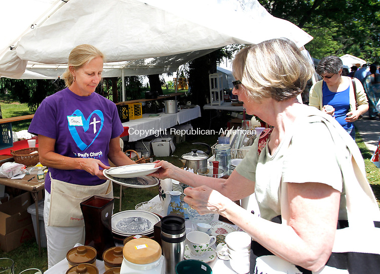 "Woodbury, CT-16 June 2012-061612CM09- Volunteer Joan Wilson (left)  assists, Pat Strub of Southbury wish dish ware at the ""white elephant"" tent during the St. Paul's Episcopal Church Fair, Saturday morning in Woodbury. The fair welcomed patrons with a silent auction and treasure chest, food, games, baked goods, an art gallery and more.  Proceeds from the fair will benefit the church and their outreach program, which provides money for scholarships and supports the local community.   Christopher Massa Republican-American"